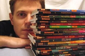 Christopher Maselli with his books